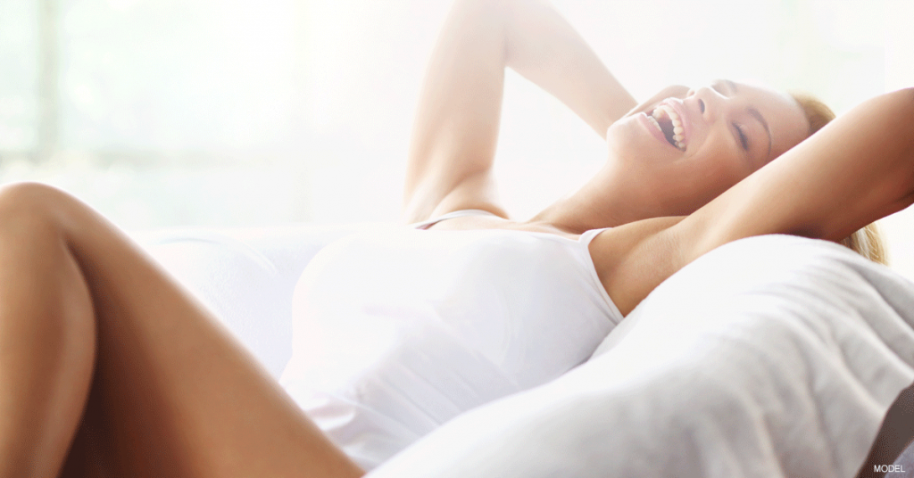 Woman lying on back after breast augmentation